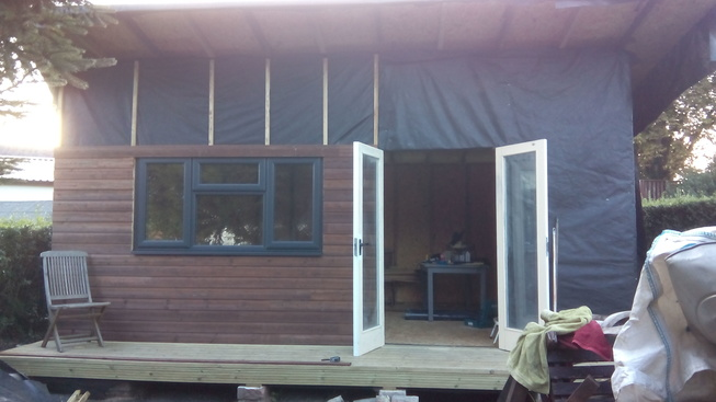 Cladding went on quite quickly, over battens into OSB